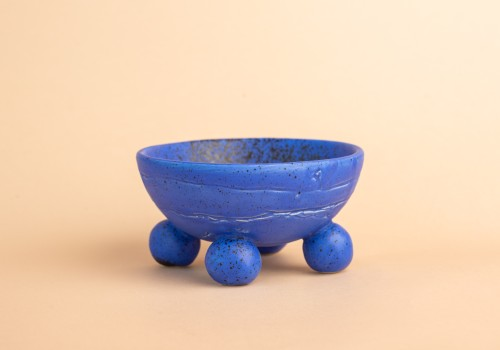 Blue ceramic container with black dots